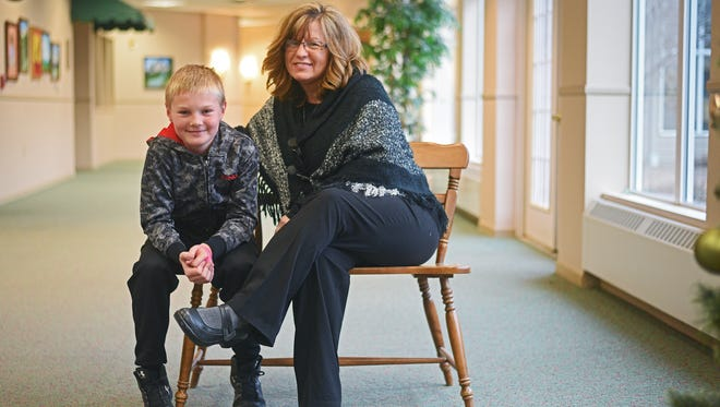 Carmen Dougherty and her nephew Bryan Dougherty, 10, pose for a portrait Wednesday, Nov. 30, 2016, in Brandon, S.D. Carmen and her husband are Bryan's guardians, and used to take Bryan to visit his mother at the Family Visitation Center.