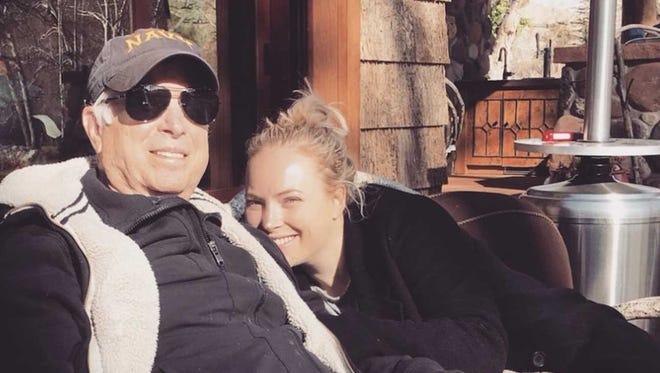 Sen. John McCain and his daughter Meghan relax outside the family's cabin near Sedona.