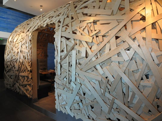 """This is a view of a dining A birch wood hut know as """"the nest"""" encloses one dining area at Cerulean restaurant, on the first floor of The Alexander hotel in Downtown Indianapolis."""