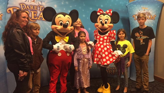 """Dreams come true Disney on Ice gave local nonprofit 100 tickets to their recent Dare to Dream Disney on Ice show at the Ford Center.  Journey Kessler and her family were among those receiving tickets from Granted, formerly Wish Upon A Star. Journey -- pictured center posing before the show with family  and Mickey and Minnie -- was born with biliary atresia given a 0 percent chance of living. A wonderful team of experts gave Journey a new liver and a new chance at living. She was able to be a part of the Dare to Dream show on opening night helping Rapunzel and Flynn Rider, from Disney's """"Tangled,"""" release a floating lantern into the arena."""