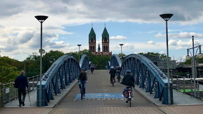Bike streets in Freiburg give residents the most direct mode of transportation throughout the city along rivers, through tunnels, and on bridges over train tracks.