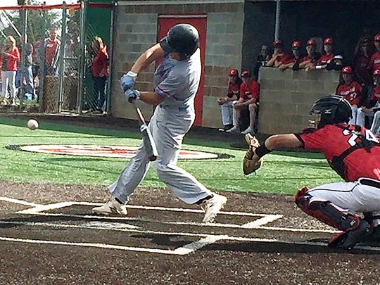 South Salem's Aaron Zavala takes a swing during Tuesday's 6A semifinal game. Clackamas won, 3-2, in eight innings.