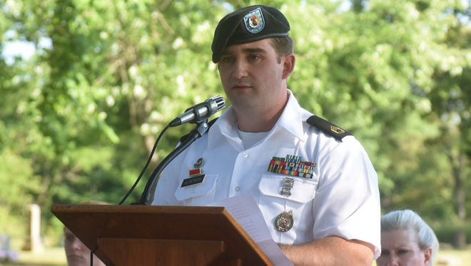 U.S. Army Sgt. 1st Class Barry Alderson talks about the importance of Memorial Day during Thursday's ceremony at the Walnut Hill Cemetery in Cotter. Alderson is the Army recruiter for the Mountain Home area.