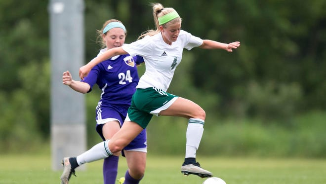 Johnston High School's Sam Birmingham tries to guard Iowa City West's Regan Steigleder during the first half Friday during their Class 3-A semifinal game at Cownie Soccer Park in Des Moines. Steigleder scored a goal in the Women of Troy's 2-1 victory.