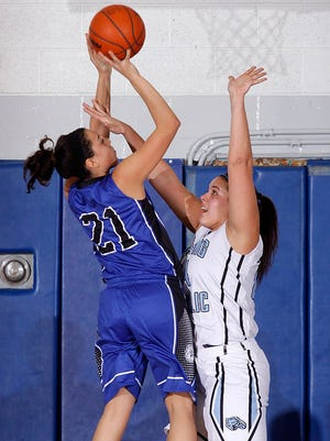 Ionia's Jaylynn Williams (21) shoots against Lansing Catholic's Maria Repichowski on Friday.
