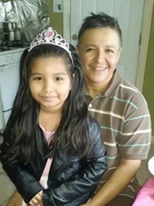 Rolando-and-daughter.jpg
