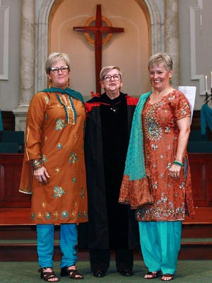 Tina Ward-Pugh and Laura Hodges Ryan were married Nov. 29, 2014, at Crescent Hill Baptist Church in Louisville, Ky. Also pictured is the Rev. Dr. Johanna W. H. van Wijk-Bos, standing between the newly married couple.