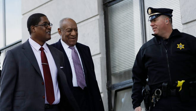 Bill Cosby and publicist Andrew Wyatt arrive for Day 8 of his sexual-assault retrial in Norristown, Pa., Wednesday.