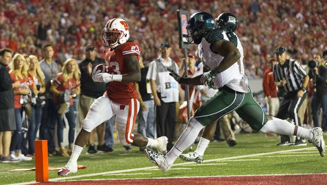 Wisconsin Badgers running back Dare Ogunbowale (23) rushes for a touchdown during the fourth quarter against the Hawaii Rainbow Warriors at Camp Randall Stadium last week.