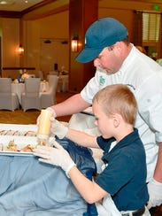 Samaritan Center student Josh works with Chef Juan