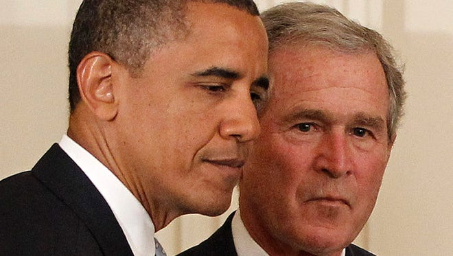 In this Thursday, May 31, 2012, file photo, President Barack Obama and former President George W. Bush take part in a ceremony in the East Room of the White House in Washington, to unveil the Bush portrait.