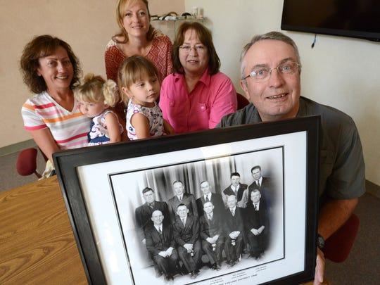 The Winick family is pictured on Tuesday, Oct. 7, at the city of Fort Collins streets facility with a photo they are donating. From right, Allan Winick, wife, Judy, with grandaughter, Peyton Sterler, 2, Chrystal Winick, and Nicole Sterler, holding daughter, Reegan, 2.