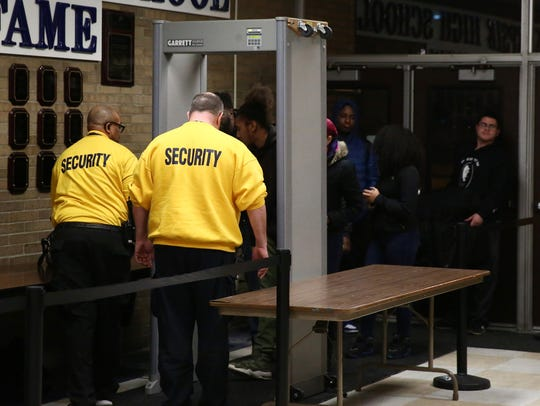 Security personnel screen spectators during Tuesday's