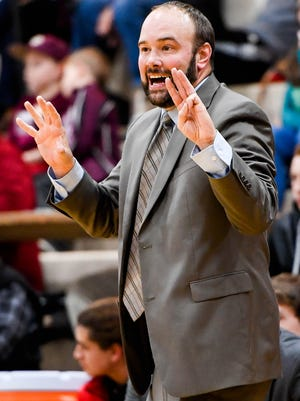 Harrison Warrior head coach Nathan Fleenor shouts instuctions to his players as the Henderson County Colonels play the Evansville Harrison Warriors for Henderson's season opener at Colonel Gym Tuesday, November 29, 2016.