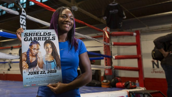 Claressa Shields poses for a photograph with a poster advertising her next fight on Wednesday, May 9, 2018 at the Downtown Boxing Gym in Detroit.
