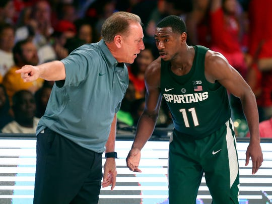 Michigan State coach Tom Izzo speaks with guard Tum Tum Nairn during MSU's win over St. John's Wednesday. Nairn tied a career-high with 13 points and set a career mark with three 3s.