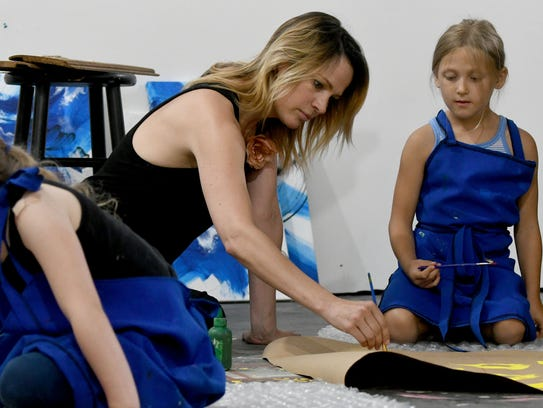 Meg Frazier works with students, Ena Bophy, 5, and
