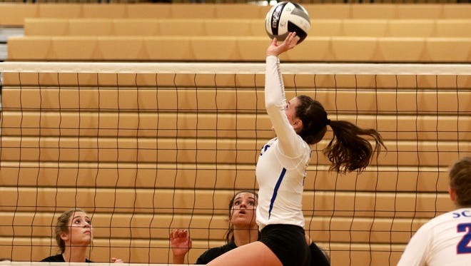 Highland senior Taylor Belcher goes high to complete a set during last weekend's district championship clinching match against Pleasant at Buckeye Valley. The Scots will play Huron Saturday at 2 p.m. at Milbury Lake High School for a Division III regional championship.