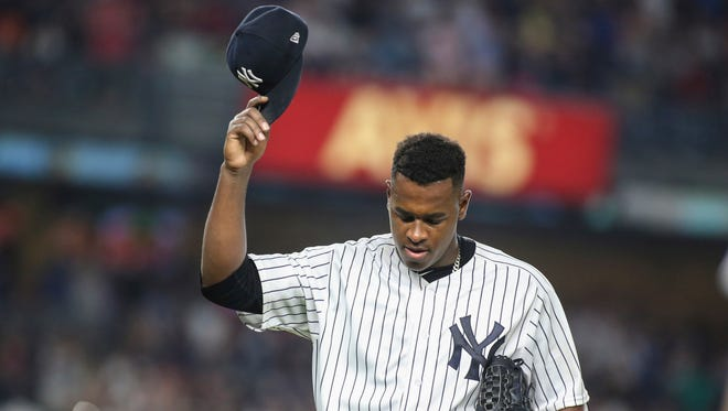 New York Yankees pitcher Luis Severino (40) acknowledges the fans as he is taken out of the game in the seventh inning.