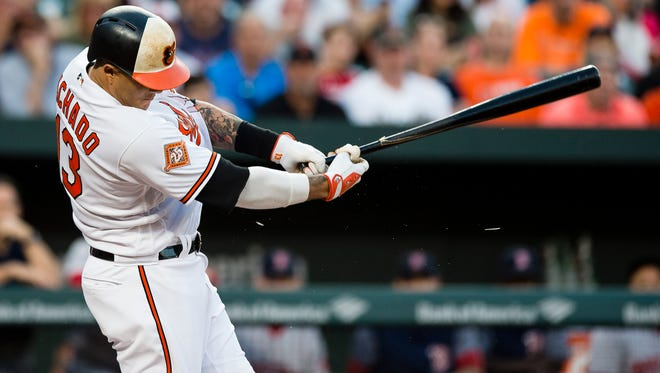 The Orioles' Manny Machado takes a swing in the third inning against the Red Sox at Oriole Park at Camden Yards in Baltimore.