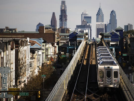 In this Wednesday, Oct. 26, 2016 photo, a train moves along the Market-Frankford Line in Philadelphia. Philadelphia's transit strike ended Monday, Nov. 7, 2016 in its seventh day. The Southeastern Pennsylvania Transportation Authority said it has reached a tentative-five year deal with the union representing about 4,700 workers early Monday morning. (AP Photo/Matt Rourke)