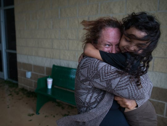 Wanda Carpenter hugs her seven-year-old daughter Samantha