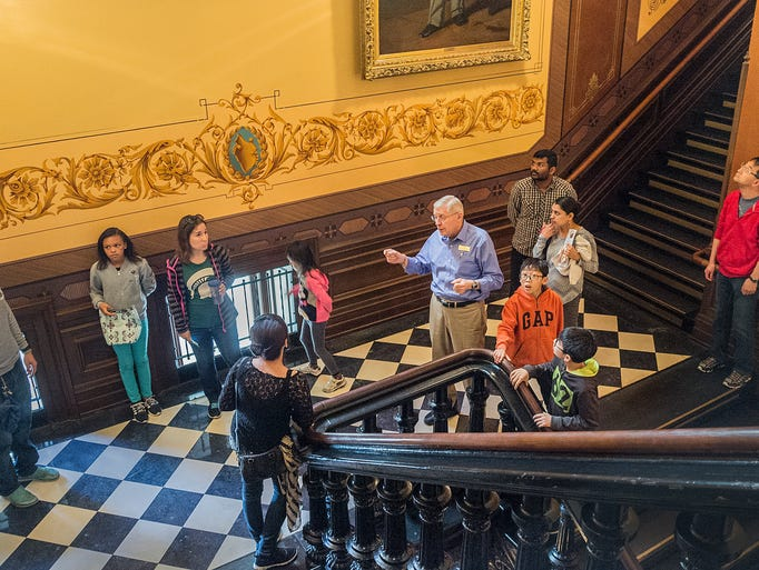 Capitol Docent John Folker leads a tour of the Capitol