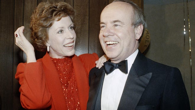 "FILE - In this April 26, 1986 file photo, Carol Burnett, left, and veteran comrade in comedy Tim Conway laugh during a gala birthday party for Burnett in Los Angeles. Conway, the impish second banana to Burnett who won four Emmy Awards on her TV variety show, starred aboard ""McHale's Navy"" and later created a very short character named Dorf, has died. He was 85. Conway died Tuesday morning, May 14, 2019, in a Los Angeles care facility after a long illness, according to Howard Bragman, who heads LaBrea Media. (AP Photo/Nick Ut, File)"