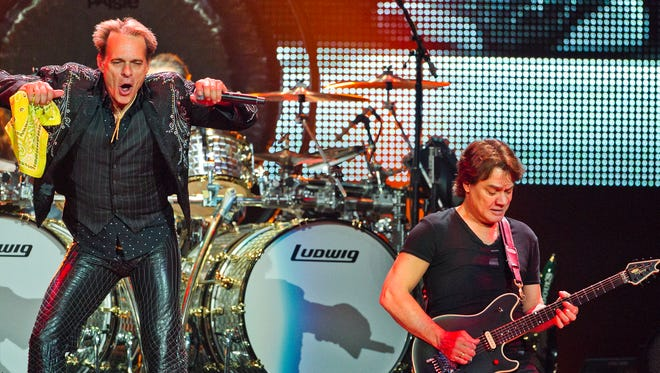 Van Halen's David Lee Roth, left, and Eddie Van Halen perform at U.S. Airways Center in Phoenix during the group's A Different Kind of Truth Tour.  The band plans a 2015 summer tour set to launch in Seattle in July.