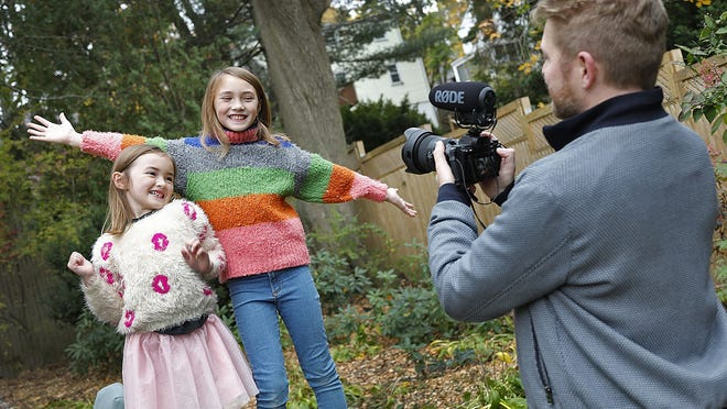 Sisters Esme, 6, and Olivia, 10, goofing around as their dad, Adam, captures it on video. Greg Derr/ The Patriot Ledger