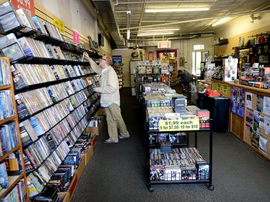 Edward Stamey looks through DVDs at Orbit DVD in West Asheville on Thursday. Stamey said he shops at the video store whenever he is in West Asheville.