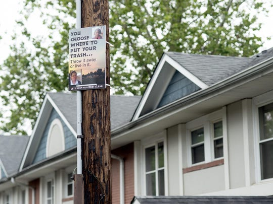 A sign encouraging residents not to litter hangs on a post at Hillcrest Apartments on Friday. A newly formed girls group at the housing community made the signs as a project to help improve their community.