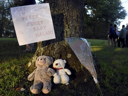 A memorial to missing toddler Nalani Johnson, a 1-year-old from Penn Hills, who was reported missing over the weekend is displayed by a tree in Pine Ridge Park, Tuesday, Sept. 3, 2019, in Blairsville, Pa. Indiana County District Attorney Patrick Dougherty said the body of Johnson, who was to turn 2 this month, was found in Pine Ridge Park in Blairsville, about 37 miles (60 kilometers) east of Penn Hills, where authorities allege the girl was kidnapped Saturday evening. An autopsy was planned Wednesday to determine the cause and manner of death, he said. (Christian Snyder/Pittsburgh Post-Gazette via AP)