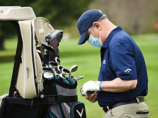 Bob Roth goes through a box of tees while playing golf Friday, May 15, 2020, at Valley View Golf Course in Utica.