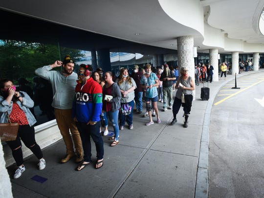 Guests wait outside to enter Turning Stone Resort Casino on Wednesday, June 10, 2020 in Verona. The Oneida Indian Nation has opened its three casino locations on Wednesday, but is following its own phased approach to reopening, calling this Phase 1. During this phase, the casinos will operate under a new Safer Together plan. The new guidelines include mandatory face coverings for staff and visitors in most areas, social distancing, enhanced cleaning protocols, no scheduled concerts until further notice and no visitors from outside a 120-mile radius.
