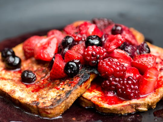 Fresh berries grilled in a make-shift alluminum pan top French Toast also grilled over coals.