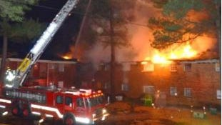 Memphis fire crews use a ladder truck at the Eastwood Park apartment fire Tuesday night.