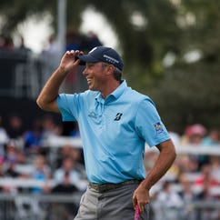 Matt Kuchar is all smiles after sinking the final putt to seal the tournament victory during the final round of the Franklin Templeton Shootout at Tiburón Golf Club at The Ritz-Carlton Golf Resort Saturday, Dec. 10, 2016 in Naples.