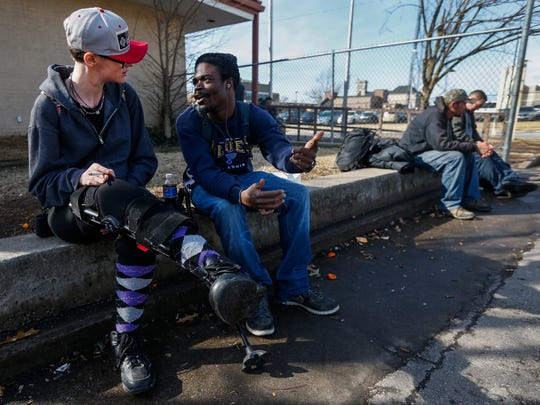 Mirenda Barrows talks to Chase Parker at the Veterans Coming Home Center on Thursday, Feb. 15, 2018. Barrows was pregnant when she was hit by a truck while crossing the street in June 2017. She suffered extensive injuries and lost her baby.