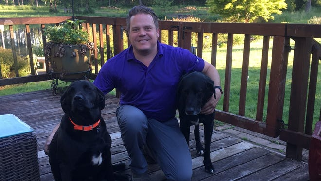 Kyle Freres, Vice President, with his two dogs Chase and Lewis. Both dogs are mutts that were rescued. Chase is 3 years old and Lewis is almost 10.