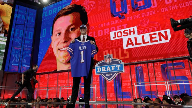 Wyoming's Josh Allen poses with his Buffalo Bills jersey during the first round of the NFL football draft, Thursday, April 26, 2018, in Arlington, Texas. (AP Photo/David J. Phillip)