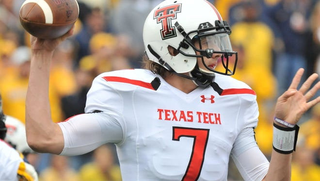 Texas Tech quarterback Davis Webb looks downfield to throw in the first quarter of the undefeated Red Raiders' win at West Virginia last Saturday.