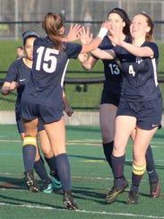 Farmington senior Erin Abramczyk (4) celebrates the