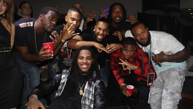 Waka Flocka Flame poses with his friends at his and Lil Wayne's Pre-Super Bowl Party at the Cultured Pearl in Scottsdale on Friday, Jan. 30.