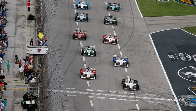 Drivers take a yellow flag during a warm up lap at the start of the Firestone 600 IndyCar auto race at Texas Motor Speedway Saturday, June 6, 2015, in Fort Worth, Texas.