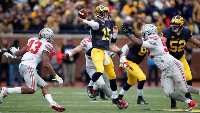 Michigan quarterback Jake Rudock passes against Ohio State in the first half at Michigan Stadium on Nov. 28, 2015, in Ann Arbor.