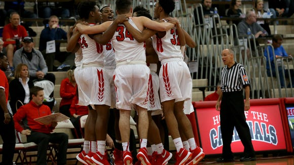 The Pike Red Devils get pumped before the game against New Albany during the Tip Off Classic on Dec. 12, 2015.
