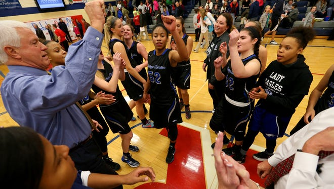 The Heritage Christian Eagles meet at mid-court after an overtime win against Roncalli in high school girls basketball action on Dec. 3, 2015.