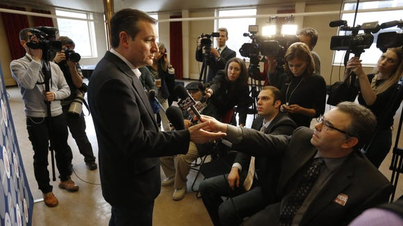 Ted Cruz talks with reporters before a rally at the