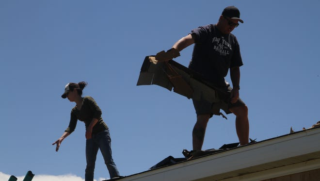Last year, volunteers from Mission Carlsbad help residents refix their roof.